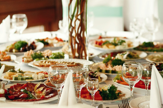 Tasty snacks with vegetables and meat stand on the round table
