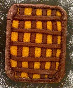 Crostata con frolla al cioccolato e marmellata di mandarino